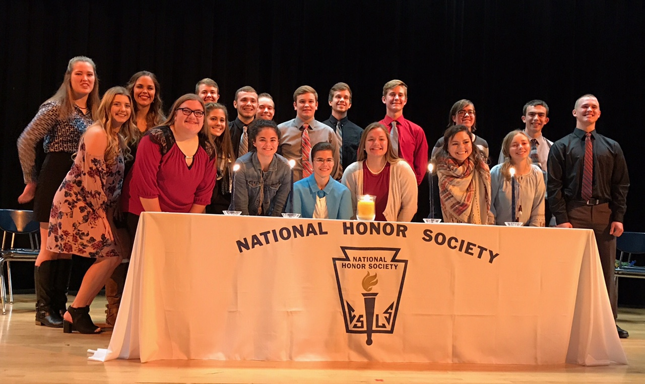 Group photo on stage with NHS inductees.