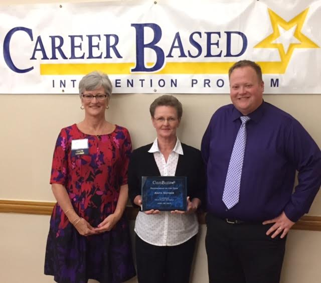 Anita Snyder honored as CBI Mentor pictured with plaque