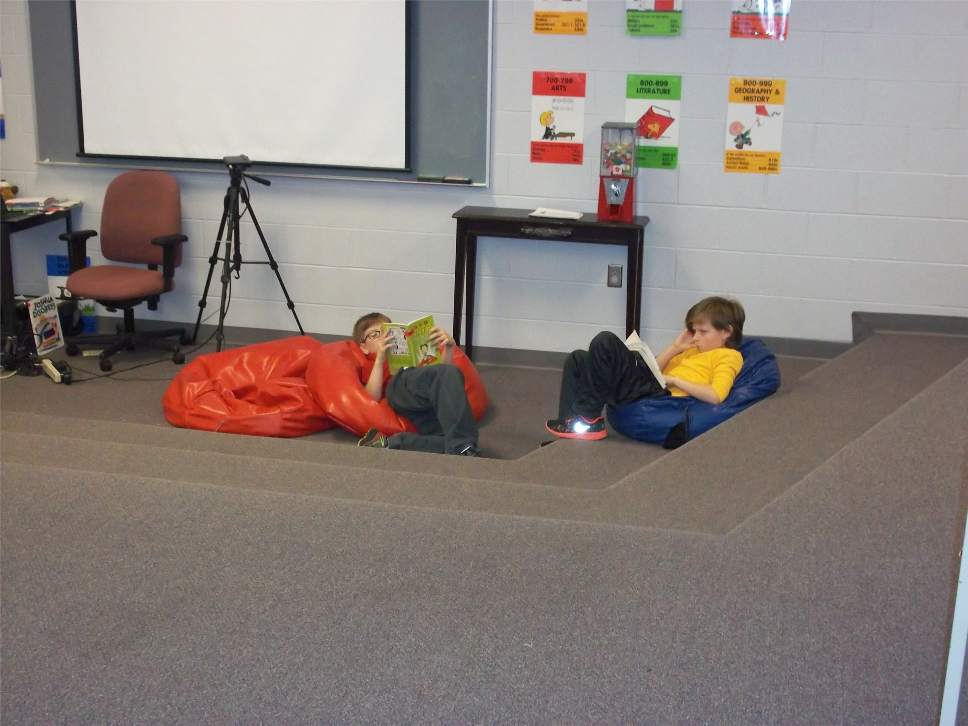 Students reading in story pit.