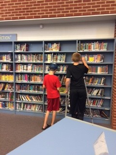 Students looking for books.