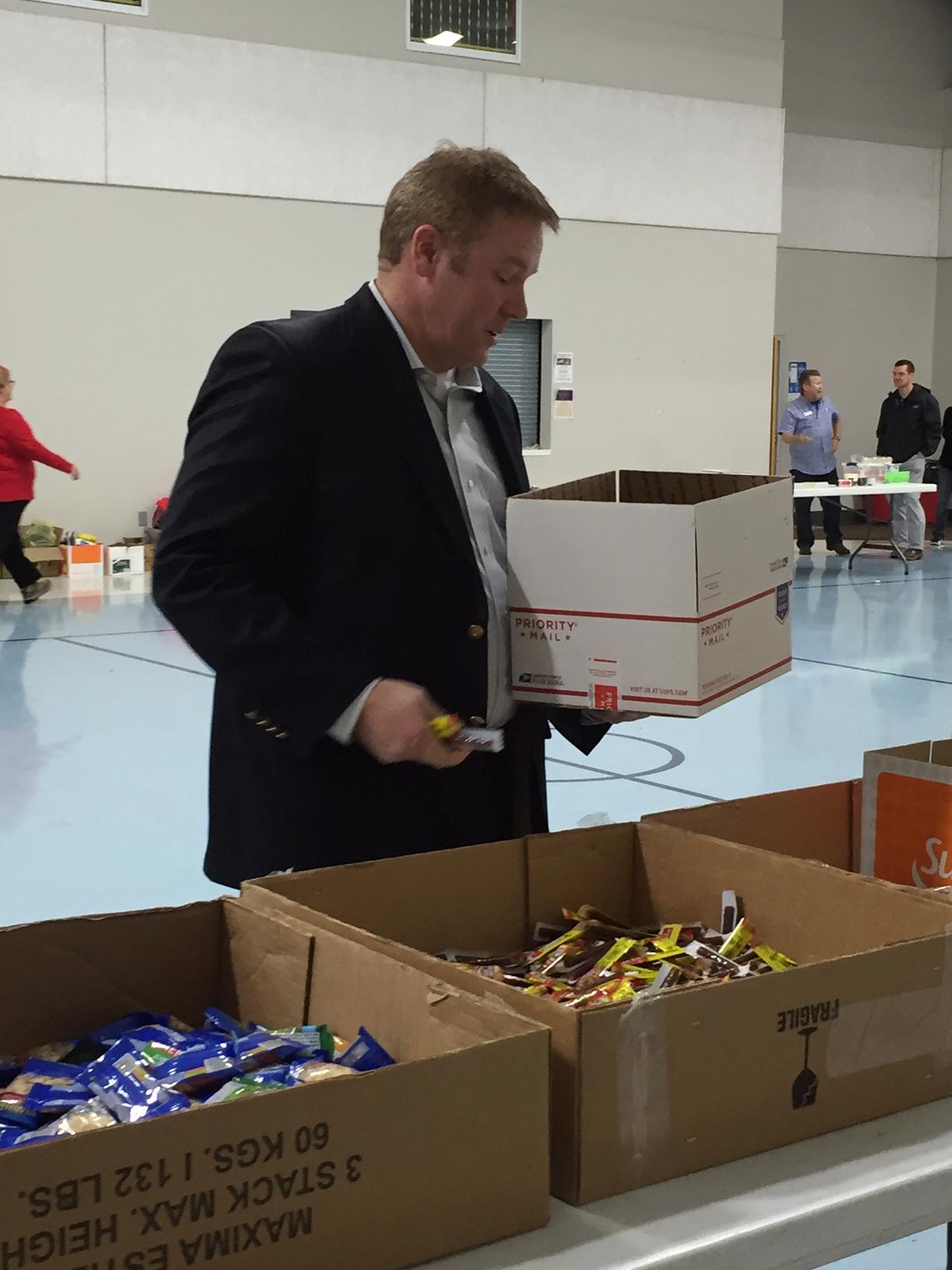 TVS CBI Students help Blue Star Moms pack food.