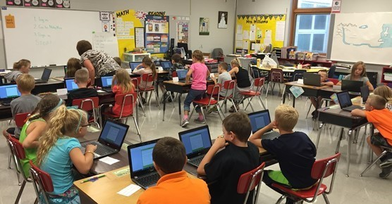 2nd Grade students using computers in class.