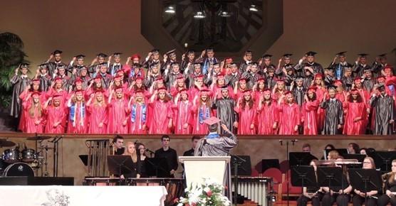 2016 Graduation group photo of tassel turning.