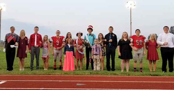 Homecoming Court 2017 pictured on football field.