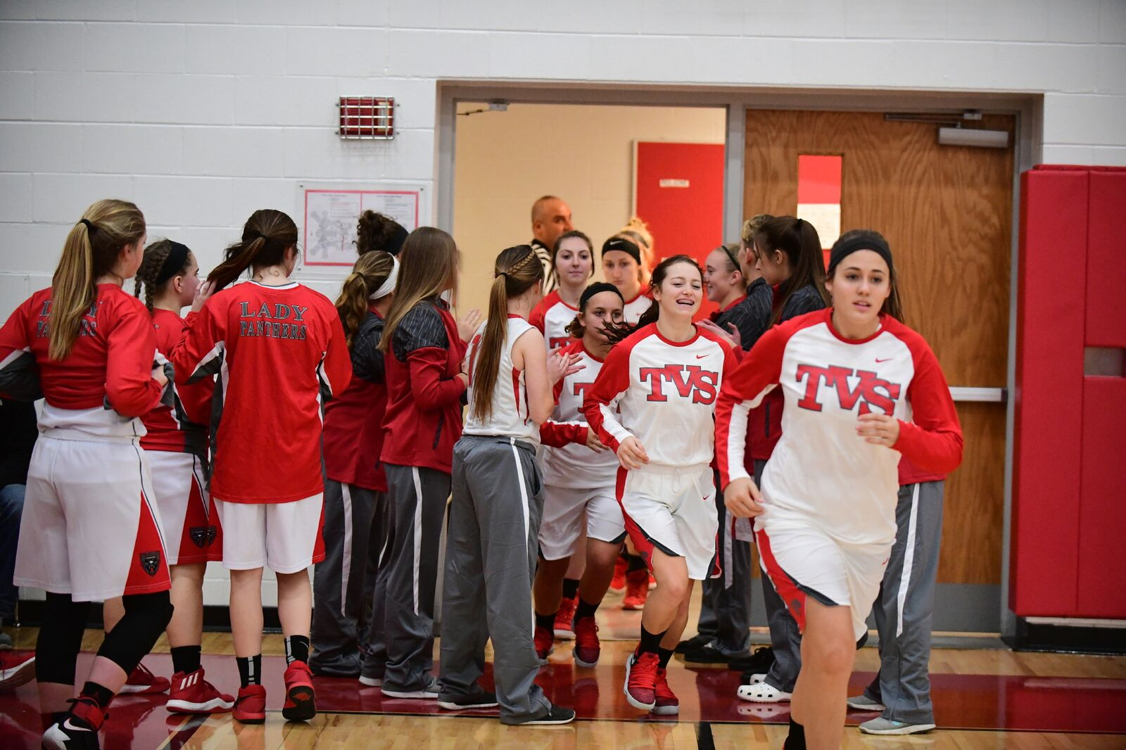 The girls Varsity team takes the floor.
